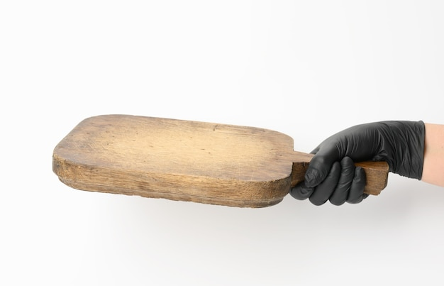 Woman holding very old empty brown rectangular wooden board in hand, body part