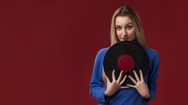 Woman holding a vinyl disc