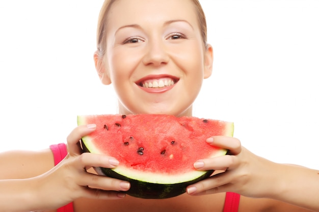 Woman holding watermelon ready to take a bite