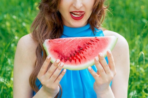 Woman holding watermelon.