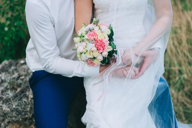 Woman holding wedding flowers bouquet