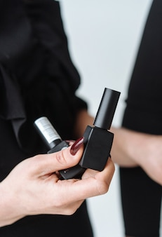 Woman holds black mascara in her hand