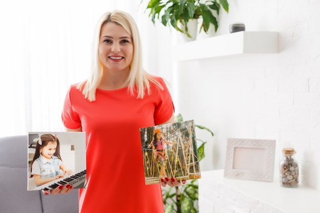 Woman holds canvas at home