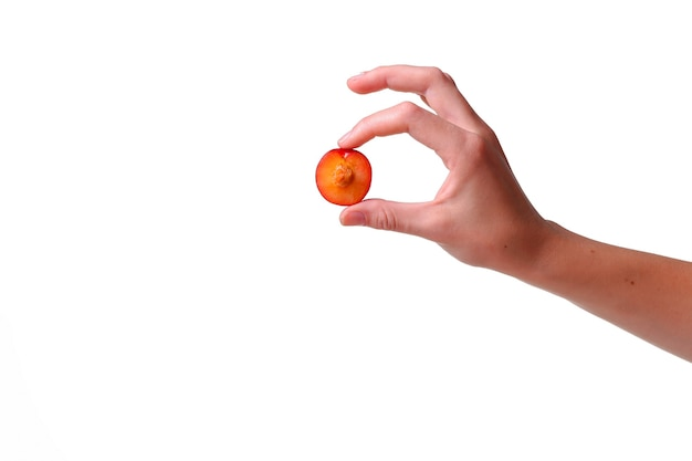 Woman holds plum in hands on an isolated white background. idea and concept of healthy eating