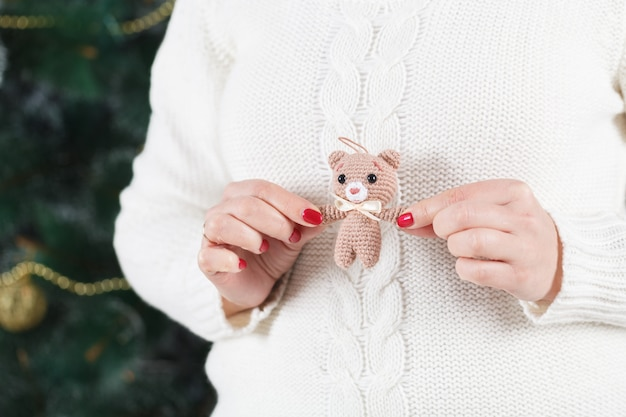 Woman holds soft toy bear