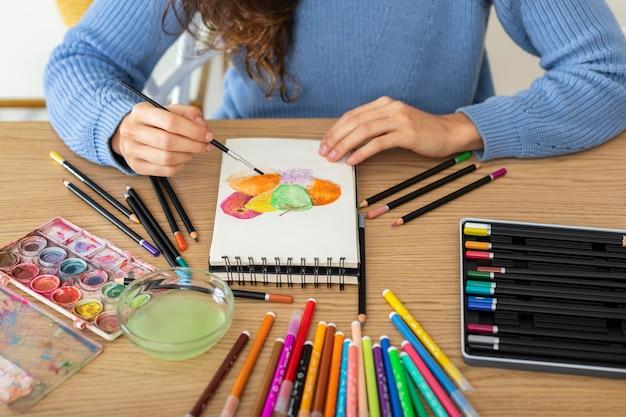 Woman at home drawing