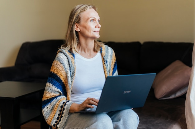 Woman at home during self-isolation with laptop