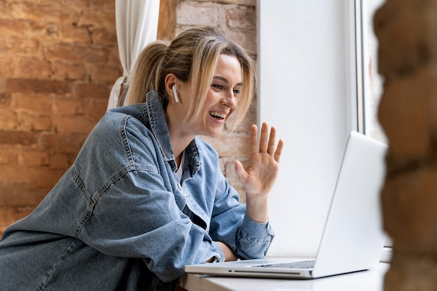 Woman at home having videocall with family
