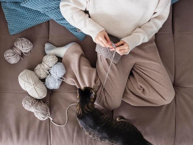 Woman at home knitting close up