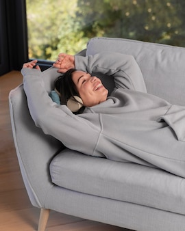 Woman at home listening music