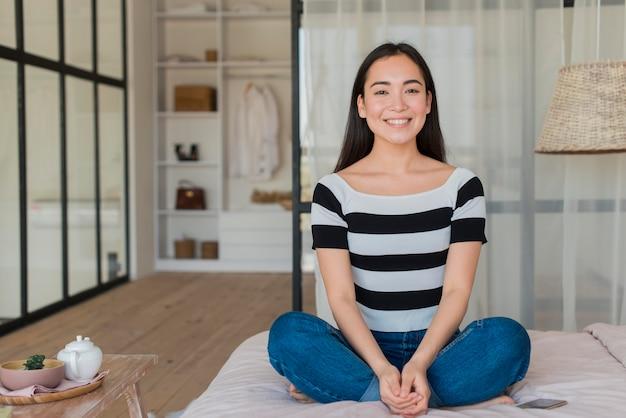Woman at home meditating