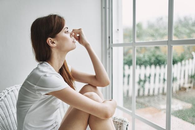 Woman at home near window