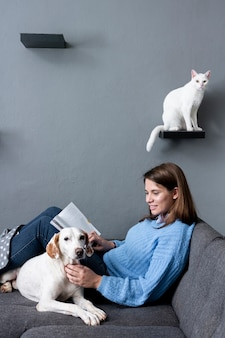 Woman at home with cat and dog
