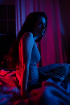 Woman at home with mysterious bedroom lights