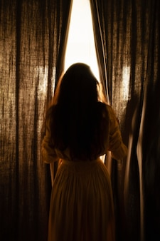 Woman at home with mysterious day lights around her