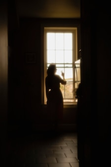 Woman at home with mysterious lights around her