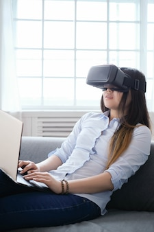 Woman at home with vr glasses