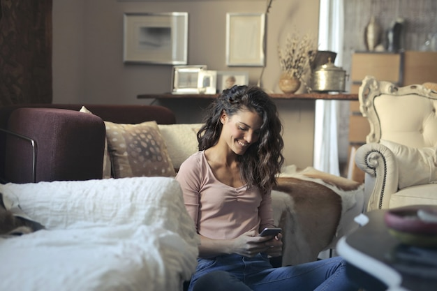 Woman at home write with smartphone