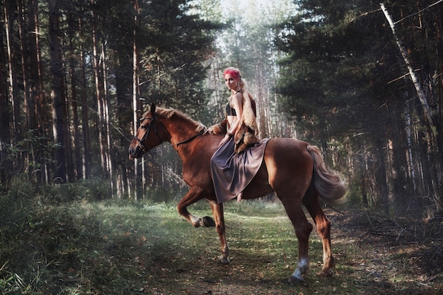 Woman on a horse. creative pink makeup on face