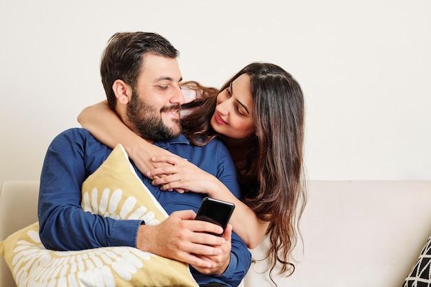 Woman hugging boyfriend