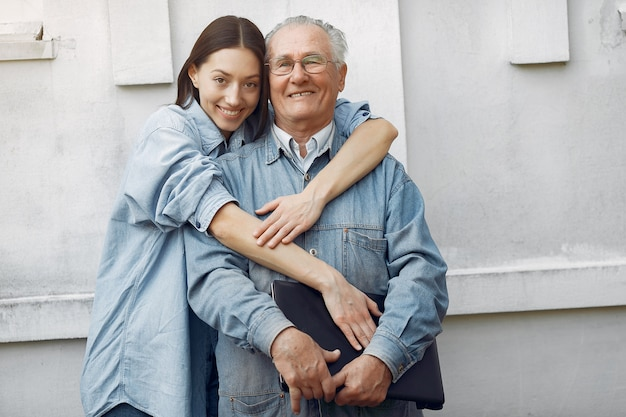 Woman hugging her grandfather
