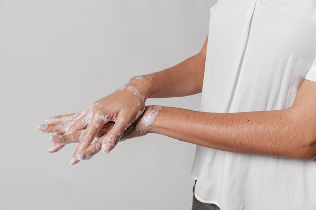 Woman hygiene concept washing hands with soap