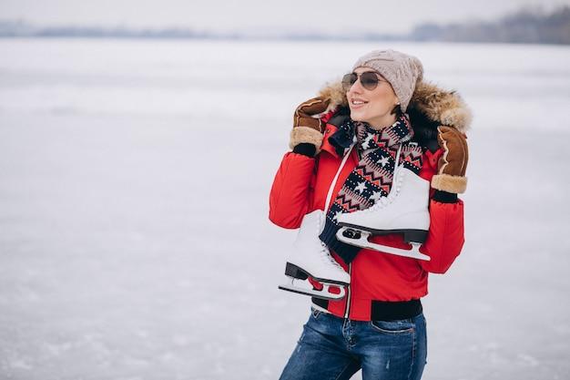 Woman ice skating at the lake