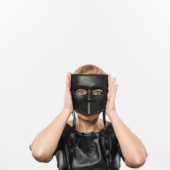 Woman in big black carnival mask