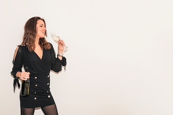 Woman in black drinking champagne from glass