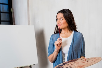 Woman in front of canvas