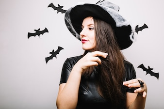 Woman in Halloween hat playing with hair