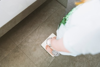 Woman in light clothes in bathroom