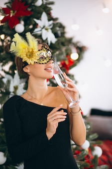 Woman in mask on Christmas masquerade