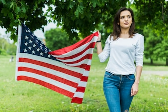 Woman in nature with american flag