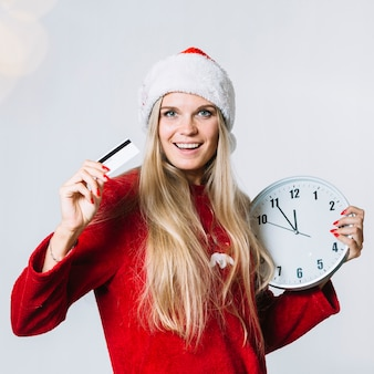 Woman in red clothes with clock and card