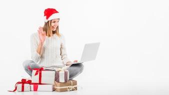 Woman in Santa hat making video call