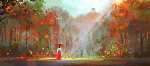 전통적인 동양 옷을 입은 여자가 울창한 숲에서 산책합니다.