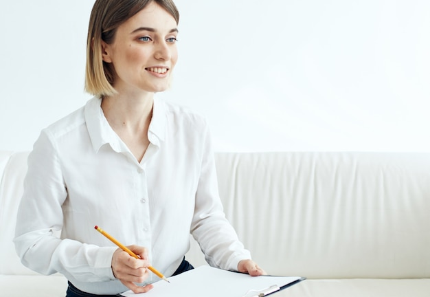 Woman indoors in shirt with document folder in hands mockup