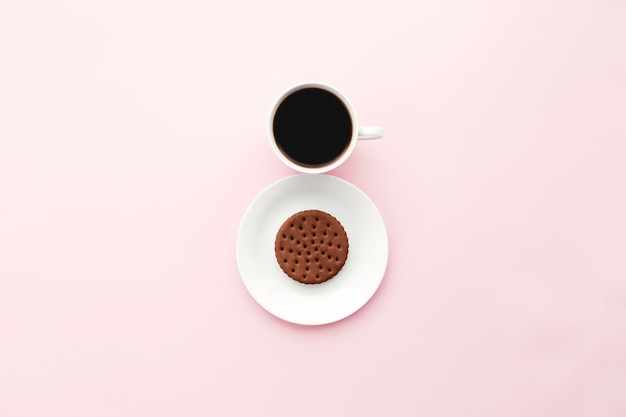 Woman international day concept, coffee cup, plate, cookie on pink background. high quality photo