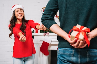 Woman inviting present from man