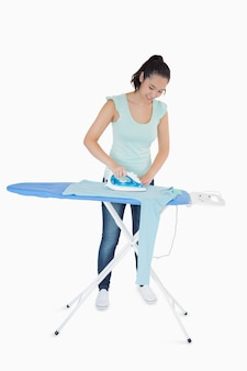Woman ironing a jumper