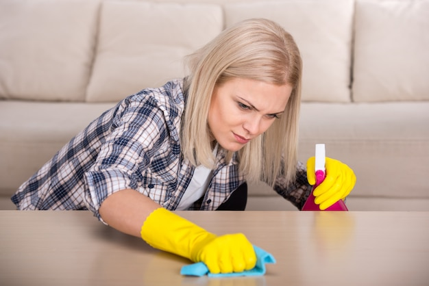 Woman is doing some cleaning work in the house.