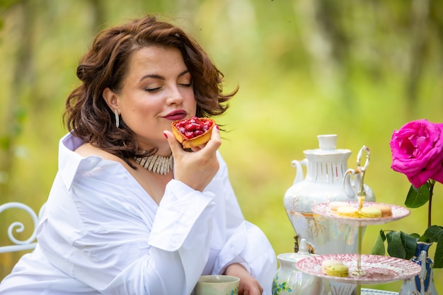 Woman is drinking coffee in the morning on the nature