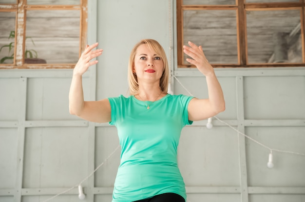 A woman is engaged in chinese martial art in the studio. woman and tai chi.