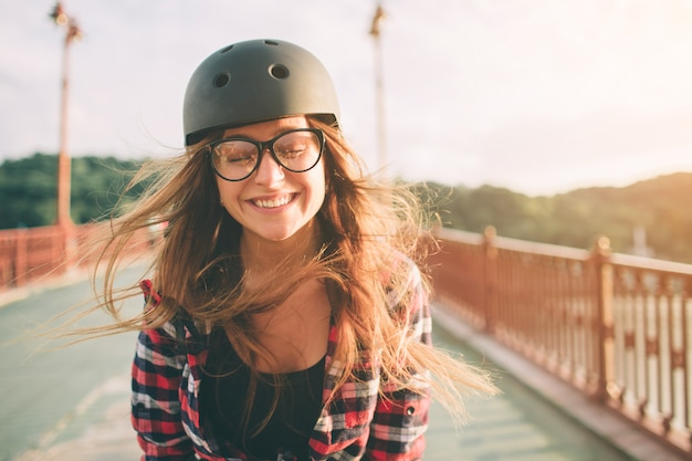 Woman is an extreme sport helmet. summer active vacations in the city. extreme sports.