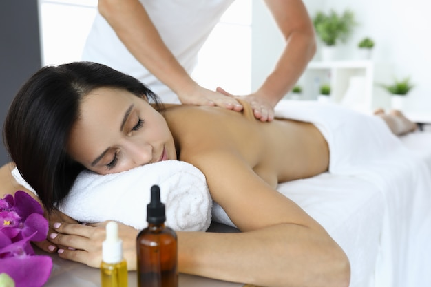 Woman is given massage to relieve tension and stress.