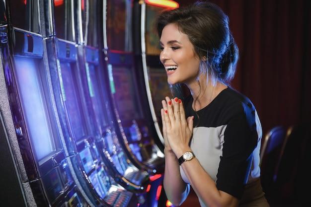 Woman is happy of her win in slot machines