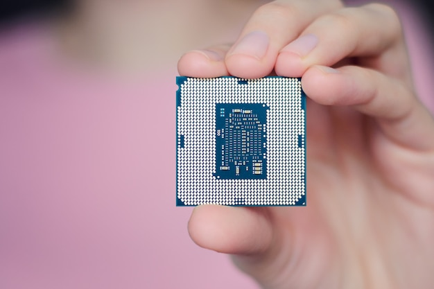 A woman is holding a central processor.