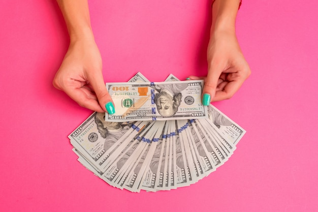 A woman is holding money in her hands