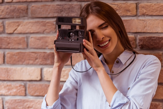 Woman is making photo with camera.